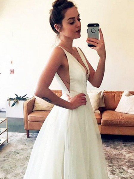A-Line/Princess Sleeveless V-neck Tulle Sweep/Brush Train Ruched Wedding Dresses
