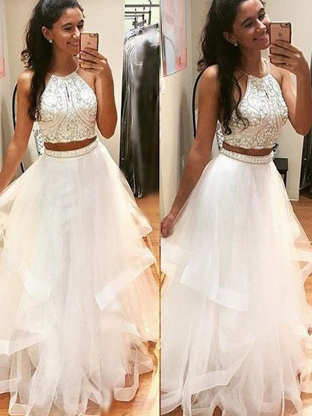 A-Line/Princess Sleeveless Tulle Halter Beading Floor-Length Dresses